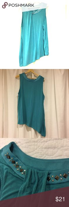 { Lane Bryant } Sleeveless Asymmetrical Tunic LB Size 22/24. This lovely teal-colored top looks beautiful with leggings as well as jeans. Neckline is trimmed with black & graphite jewels, and accented with gathered material. Throw on a cardigan or wrap over this top in the cooler weather. You will receive a LOT of compliments on this! Machine-washable, no damage. Smoke-free home. Lane Bryant Tops Tunics