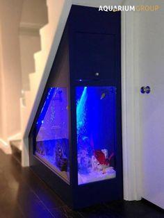 A hyper-modern staircase with a built-in aquarium by AquariumGroup