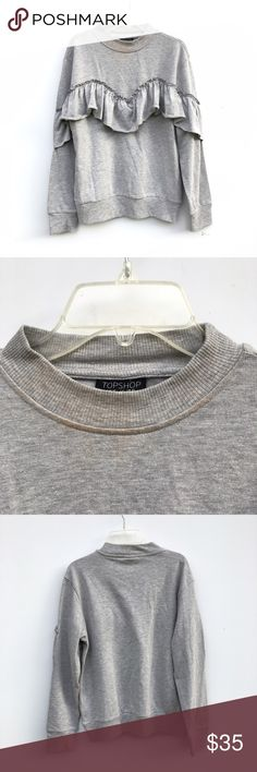 NWOT Topshop Ruffle Sweatshirt Brand new and without tags light gray sweatshirt with a ruffle. Stains near neckline but purchased from retailer that way. Topshop Tops Sweatshirts & Hoodies