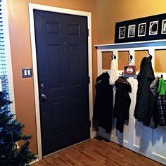 DIY coat rack / dark door Sherwin Williams Empire Gold