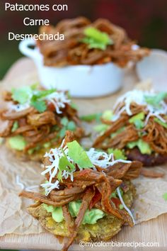 Patacones con Carne Desmechada (Fried Green Plantains with Shredded Beef).I would skillet fry these in avocado or coconut oil. And I would skip the cheese - might use a cashew queso sauce instead. My Colombian Recipes, Colombian Cuisine, Mexican Food Recipes, Beef Recipes, Snack Recipes, Cooking Recipes, Latin Food Recipes, Colombian Arepas, Kitchen Recipes