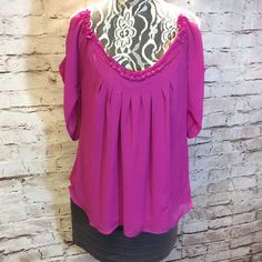 SZ LG NICOLE BY NICOLE MILLER COLD SHOULDER BLOUSE Stunning blouse in fuchsia with cold shoulder sleeves and a loose fit. See pic of a pull in material but unless someone is very close its not very noticeable. Beautiful piece Nicole by Nicole Miller Tops Blouses