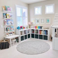 A Reimagined Playroom – Project Nursery kid playroom design in basement iwth toy storage, cubby storage for kid toys, play table and play house in neutral playroom design, bonus room in basement for kid space