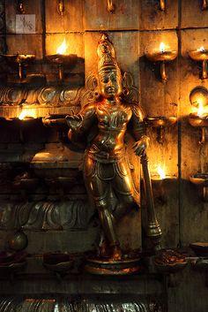 Illuminated Hindu god figurine, Meenakshi-Sundareshwarar Temple, Madurai, Tamil Nadu, India