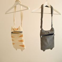 Love these adorable hungry-cat bags -- there are versions for iphones and pencil cases too!