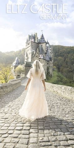 Pinterest pin for Burg Eltz Castle - Woman standing in front of the castle