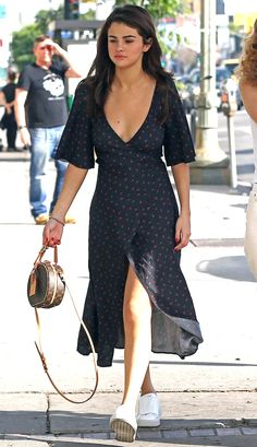 SELENA GOMEZ wearing a navy and red Bec & Bridge wrap dress, white sneakers and a small Louis Vuitton bag in Beverly Hills