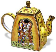 A Miniature teapot with a reproduction of the painting The Kiss by Gustav Klimt from the Art Nouveau period (c. 1907).