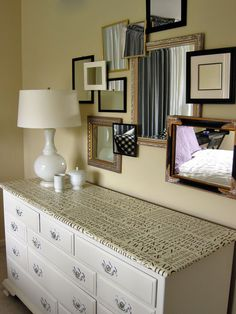 3D Mirror  Gallery Wall.  Mirrors raised from the wall with blocks of wood to add more interest.