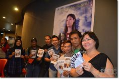 Film producer Juliet Tan (right) with the cast of 'Sada Pengerindu' including Vincent Mallang (fourth left) posing before the movie screening at Star Cineplex on June 20.