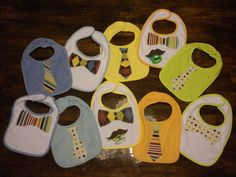 Mustache pacifiers and tie and bow tie bibs