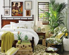 This room has a British Colonial feeling to it. While there are many tropical elements in the space, including palm prints, rich greens, natural materials, the overall tailored feeling shows the influence of British style in the tropics.