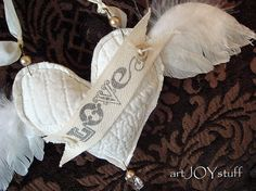LOVE quilt scrap stuffed fabric heart with wings by ajoy2bheld, $17.50