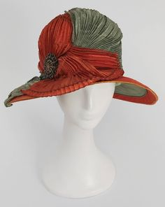 f2cb9076c1d054 View this item and discover similar hats for sale at - Burnt Orange &  Seafoam Green Wide Brim Cloche Hat. Pleated fabric drapes across the front  of this hat ...