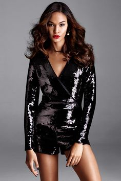 Light up the room in this black sequin long-sleeve romper with wrap-over front. | Party in H&M
