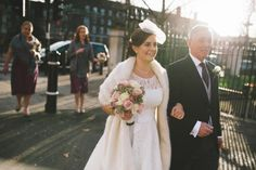 Bride on her way to the ceremony with her Father #WinterLight #Bride #WeddingFlowers