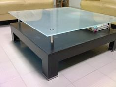 Frosted glass table top on brushed steel standoffs - allows for easily accessible storage for items like magazines and books! Would look fantastic lighted or with a red back-color! Glass Furniture, Table Furniture, Furniture Ideas, Stainless Steel Fasteners, Modern Glass, Nesting Tables, Frosted Glass, Modern Design, Barrels