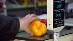Produce is placed on a scale in an Iqaluit grocery store. The Nutrition North program offers direct subsidies to retailers who ship healthy food to communities that don't have roads. Tracey Galloway says the program does little to ensure retailers are passing the savings on to consumers.