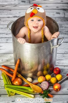 We love getting festive for the holidays, and doing fun things with our own baby. Thanksgiving Baby Photo. 10 month old in a large pot and Turkey hat. Mama's little turkey.