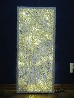 Nice art made by frames, paperstrings and LED lights.