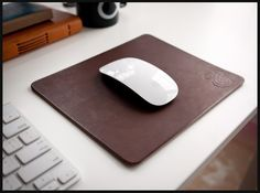 Beautify your desk with this premium leather mousepad. The thick latigo leather provides a cushion for your hand and a smooth surface for your mouse. The leather will slowly transform over time as you use it and take on a unique wear pattern according the your individual use.    http://shop.ugmonk.com/product/premium-leather-mousepad-brown