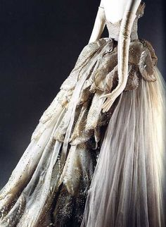"""""""Venus"""" dress, 1949  Christian Dior (French, 1905–1957)  Gray silk net embroidered with feather-shaped opalescent sequins, rhinestones, simulated pearls, and paillettes"""