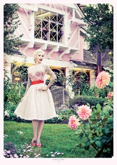 Reminds me of the white rabbit's house from Alice in Wonderland... Dress looks like Mary Poppins though