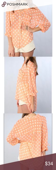 """Free People Polka Dot Easy Rider coral blouse Free People Coral Polka Dot Easy Rider Hi-Lo button down blouse. Bright coral color with white polka dots. Sheer, chiffon, lightweight, flowy material. Hi low hem. Full button down shirt. Top has collar and quarter length tab/ button sleeves. two front chest pockets. Size small. EUC, excellent used condition. Measurements taken laid flat. 21 ½"""" bust, 24 1/2'"""" length. Free People Tops Button Down Shirts"""