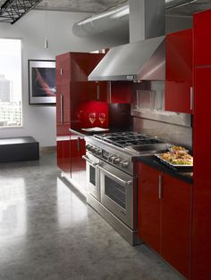 This kitchen looks so modern! Yet it still has that splash of red that I am looking for