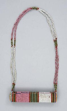 Africa | Necklace with a snuff container ~ ishungu ~ from the Zulu people of South Africa | ca. 1870 - 1929 | Glass beads and bamboo