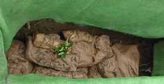 This is a peek into the grave of the final resting place of our 32 medieval skeletons, they have been placed in biodegradable paper bags Paper Bags, Skeletons, Biodegradable Products, Crib, Medieval, Outdoor Blanket, Crib Bedding, Baby Crib, Mid Century