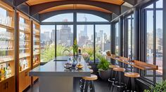Why go out for cocktails when you have your own sky bar at home? That's just what created at this Manhattan triplex. Photo by Architectural Digest, Soho Apartment, New York City Apartment, Downtown New York, York Hotels, Sky Bar, Steel Beams, Stone Kitchen, Interior Decorating