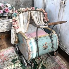 .I think this is a shabby-chic'ed baby buggy, would make a cute pet bed too...lol.