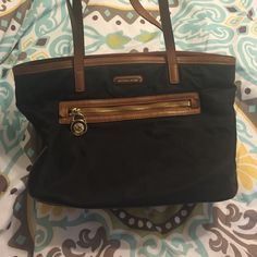 Michael Kors bag Black nylon bag with brown leather trim and handles. Some wear on handles shown in photos, otherwise in great condition. Authentic Michael Kors. Michael Kors Bags Totes