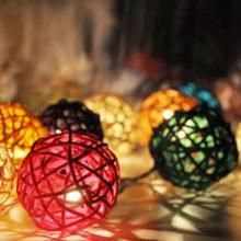 Rattan string lights are hand made in Thailand from 100% cotton string, rattan, and fallen leaves. | Green Bride Guide