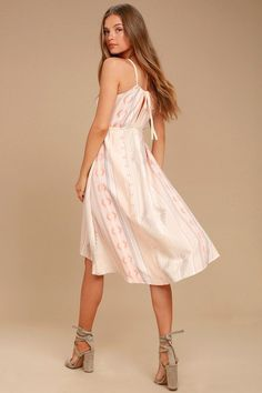 Dance under the palm trees in the O'Neill Uli Blush Pink Print Midi Dress! Woven cotton, with a grey, orange, and blue Boho print and embroidered accents, shapes a sleeveless bodice with a high neckline and drawstring straps. Fitted waist (with elastic at back) tops a midi skirt with slight high-low hem. Metal logo tag at hem,