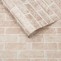 Metallic Brick Wallpaper in Rose Gold White from the Exclusives Collection by Graham & Brown