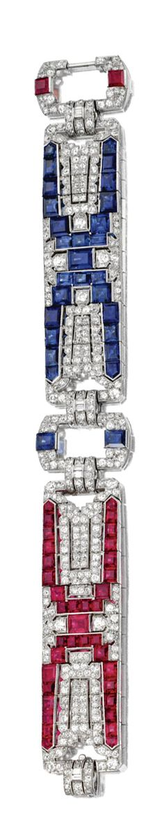 ART DECO DIAMOND, SAPPHIRE AND RUBY BRACELET, CIRCA 1930.  Composed of two articulated segments and two rectangular links alternately decorated in geometric patterns with square and bullet-cut sapphires and rubies, completed by old-mine, single-cut and baguette diamonds weighing a total of approximately 9.00 carats, mounted in platinum, length 7¼ inches.