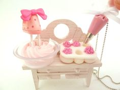 """The Bakers Necklace """" Who Ate My Cupcakes"""" Miniature Cupcake Tin Muffin Pan with fake cupcake frosting and and pink Pastry Bag charm. $26.99, via Etsy."""