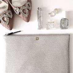 ". HP 2/7  kate spade Glitter Clutch Sparkle up your day/night with this gorgeous glitter  Clutch from ♠️ kate spade!  •Silver 3D holographic glitter •Black ""kate spade"" emblem & zipper tab •Gold plated hardware •Inside is lined & has pockets  Dimensions: 10.5 x 7.6 x 0.5 inches  NWT!  OFFERS through the ""offer"" button only please  kate spade Bags Clutches & Wristlets"