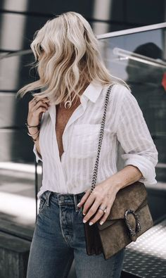 #summer #outfits One Of My Favorite Things To Wear In The Summer Is A Light Weight White Button Down And This One Is Amazing! I Wear It A Ton With Jeans, Cut-offs, And Denim Skirts, It's Super Versatile Making It A Definite Summer Staple! ➰ // Shop This Outfit In The Link