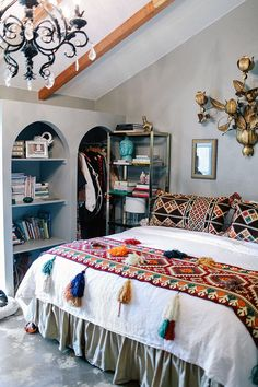 Gorgeous, bright-colored textiles and other great details in this ornate, bohemian space