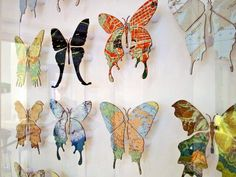 Butterflies made of sheet metal covered in vintage maps.