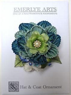 A pretty blue ribbonwork hat/hair ornament.