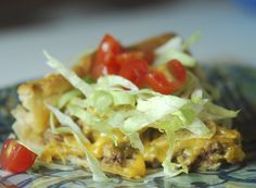 Taco pie.  Family liked this one.  Serve with lettuce, tomato, black olive, and onion.