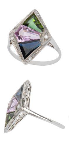 An Art Deco gem-set and diamond ring, circa 1925. Set with fancy-cut sapphire…