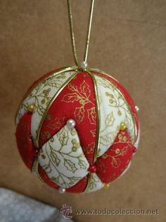 Bits of fabric cut to fit with border. Push into scored design with dull knife. Line with gold cord and pearl pins. Quilted Christmas Ornaments, Fabric Ornaments, Handmade Ornaments, Diy Christmas Ornaments, Handmade Christmas, Christmas Decorations, Christmas Patchwork, Christmas Fabric, Ornament Crafts