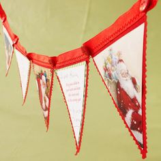 Christmas Card Banner  Hold on to too-pretty-to-toss Christmas cards for a fabric and ribbon banner. Maximize your favorite greetings by alternating triangle-cut illustrations with handwritten and printed sentiments.