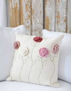 Sewing Pillows - Description - Artisan - Artisan Photo - Hang Tag Felt roses blossom atop a linen pillowcase that's finished with hand-embroidered stems. * Hand wash * Approximately x * Design on Front * Pil - Crochet Cushions, Sewing Pillows, Diy Pillows, Decorative Pillows, Throw Pillows, Pillow Ideas, Cushions On Sofa, Felt Roses, Craft Ideas