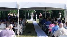 Exchanging vows at an outdoor ceremony, at the Rock Reception Hall in Coal Valley, Illinois.  Photo by Marske Music Productions - Kirk Marske, DJ & emcee, www.marskemusic.com, info@marskemusic.com